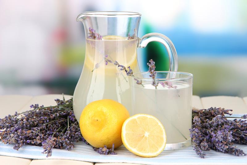 bigstock-Lavender-lemonade-in-glass-jug-59299505