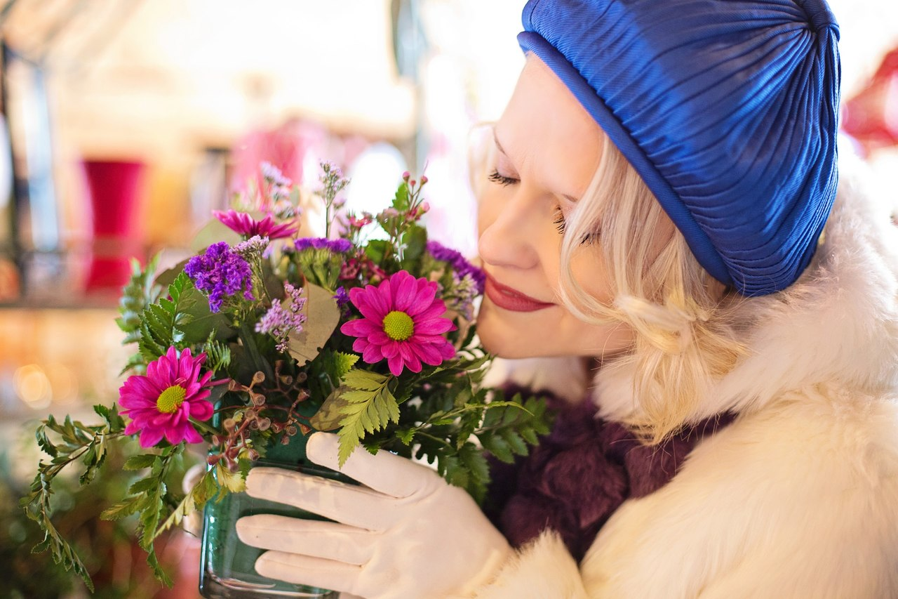 woman smelling flowers_resized
